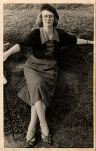 My mum at 18, modelling with style her dad's cap, glasses & walking stick!!